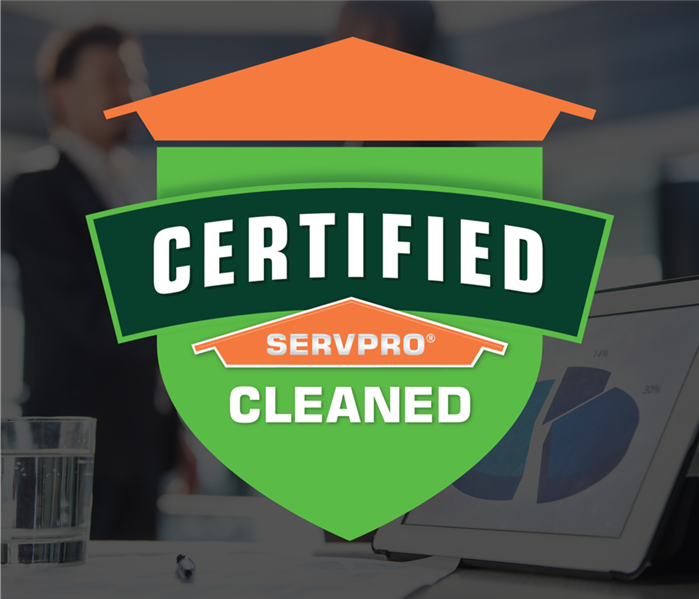 two people shaking hands with an Certified: SERVPRO Cleaned sticker over the photo